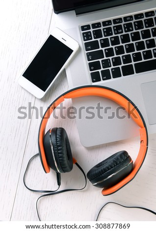 Headphones and other devices on worktop, closeup #308877869