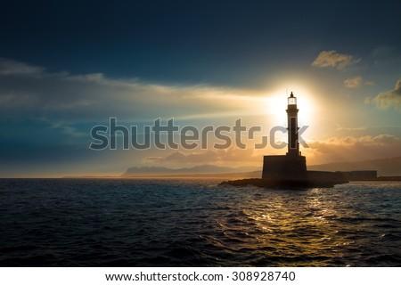 Lighthouse on sunset. Royalty-Free Stock Photo #308928740