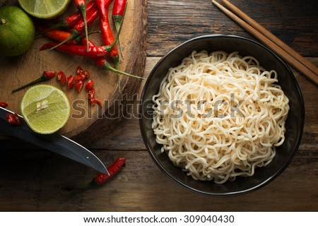 Instant noodles in white black on wood background, Top view, Asian meal on a table, junk food concept #309040430