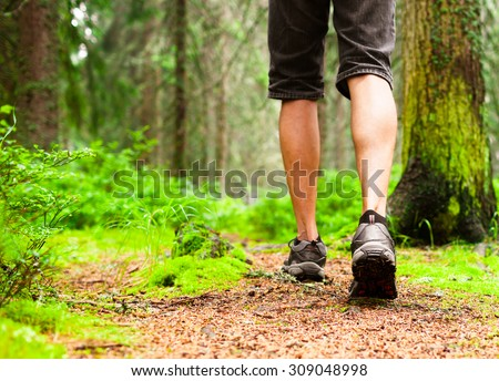 Male hiking in the woods.  #309048998