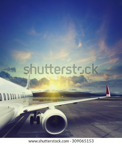 airplane taking off from the airport. fragment of the body of aircraft. business travel concept vintage style picture