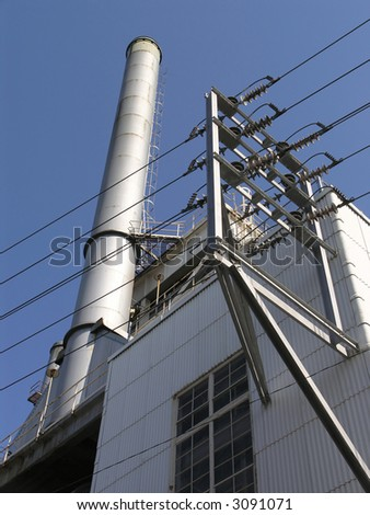Power Station with one exhaust stack against blue sky #3091071