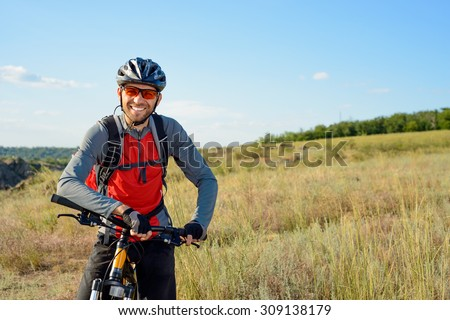 Portrait of Young Cyclist in Helmet and Glasses. Sport Lifestyle Concept. #309138179