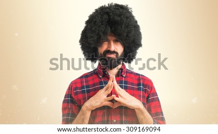 Afro man thinking over ocher background #309169094