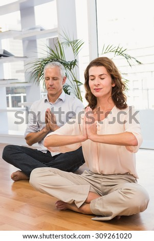 Peaceful casual business colleagues meditating in the office #309261020
