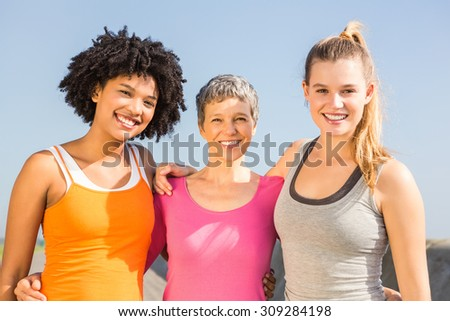 Portrait of sporty women smiling at camera at promenade #309284198