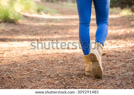 Close up view of woman hiking on path in the nature #309291485
