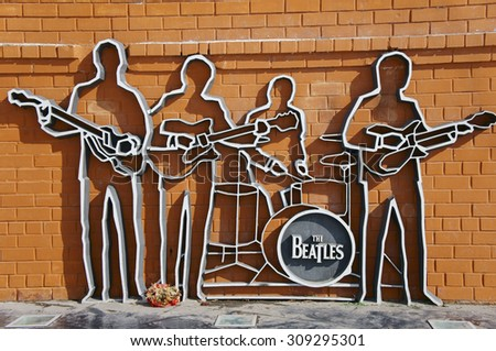 YEKATERINBURG, RUSSIA - March 26, 2012: Photo of Monument to The Beatles. The Beatles monument in Yekaterinburg. 26 March 2012. Yekaterinburg, Russia #309295301