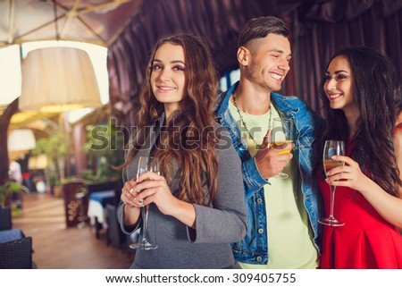 Friends at party drinking cocktails and having fun - Three tourists drinking aperitif in a restaurant #309405755