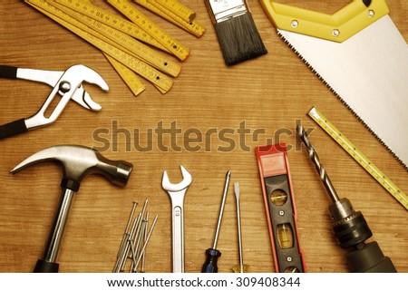 Assorted work tools on wood #309408344