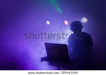 Music Dj mixing at nightclub party #309461069