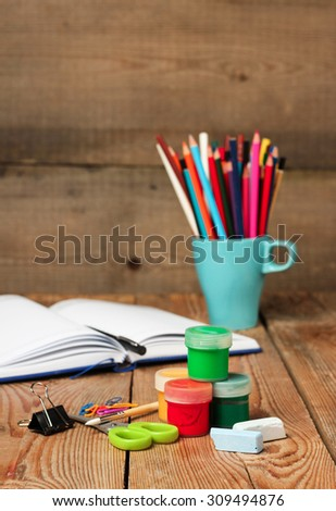 Still life, business, education concept. School supplies and open notebook on a wooden table. Selective focus, copy space, school background