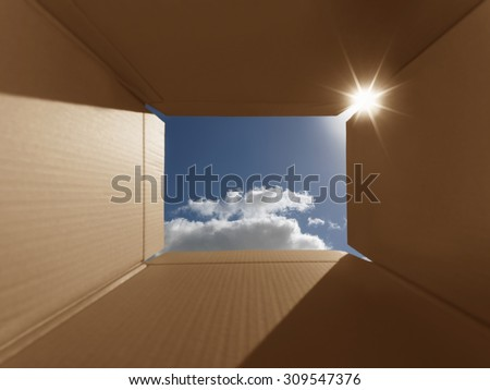 Conceptual shot illustrating the phrase 'thinking outside the box'. Implies inspirational thoughts, bright new ideas, imagination and escaping from the norm.