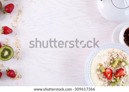Healthy homemade oatmeal on wooden table, close up #309617366