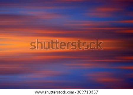 Colorful sunset with long exposure effect, motion blurred. (Shallow DOF, slight motion blur).