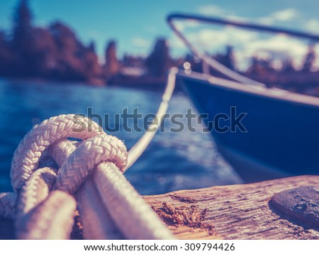 Retro Filtered Photo Of A Luxury Yacht Tied To Pier #309794426