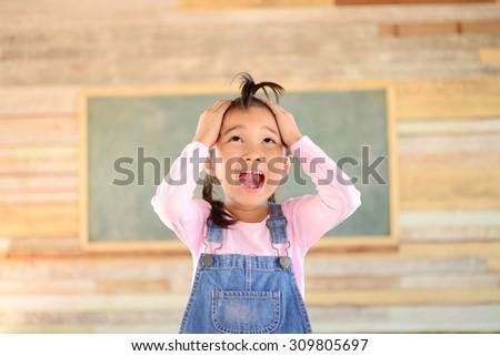 Little girl crazy pose blank green blackboard #309805697
