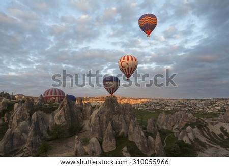 AVANOS, TURKEY - MAY 06, 2015: Photo of Balloons over Cappadocia. #310055966