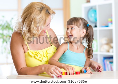 happy family - mother and child playing together with educational toys #310375856