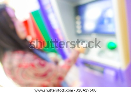 Blurred image of woman in bank use ATM machine for take money or do something about financial. #310419500