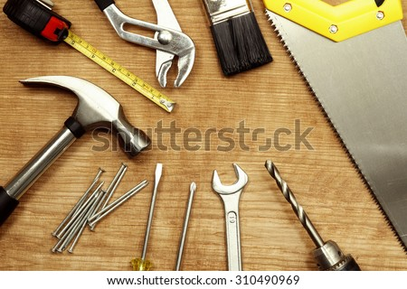 Assorted work tools on wood #310490969
