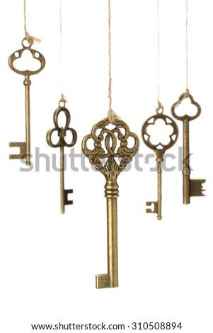 Hanging old Keys on white background. #310508894