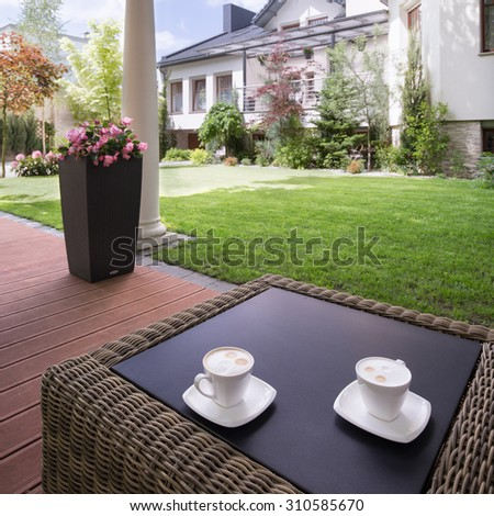 Picture of a house patio with stylish rattan table
