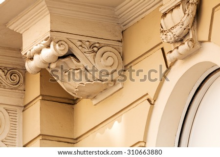 stone facade on classical building with ornaments and sculptures #310663880