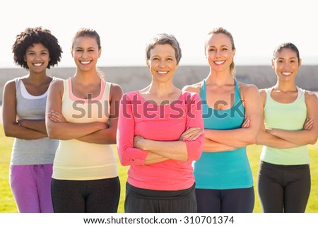 Portrait of smiling sporty women with arms crossed in parkland #310701374