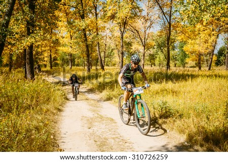 Gomel, Belarus - August 9, 2015: Mountain Bike cyclist riding track at sunny day, healthy lifestyle active athlete doing sport. #310726259