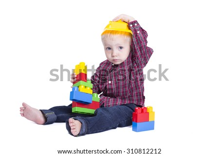 Two years old boy playing with cubes #310812212