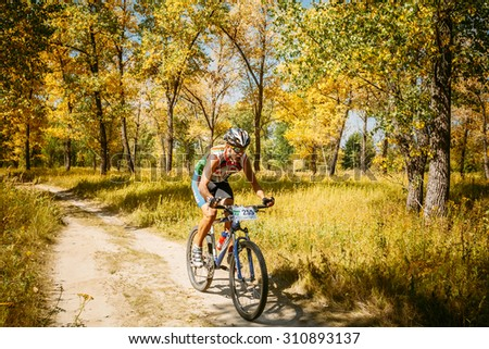 Gomel, Belarus - August 9, 2015: Mountain Bike cyclist riding track at sunny day, healthy lifestyle active athlete doing sport. #310893137