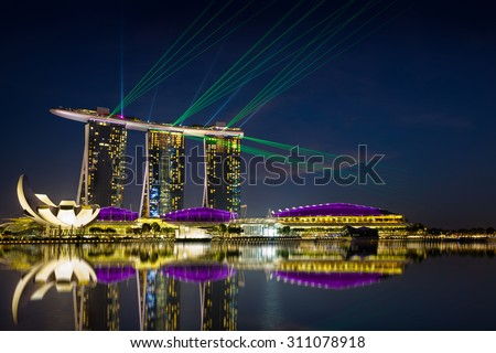 Beautiful laser show at the marina bay waterfront in singapore Royalty-Free Stock Photo #311078918