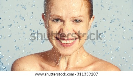 Happy beauty woman skin care, washing with splashes and drops of water #311339207