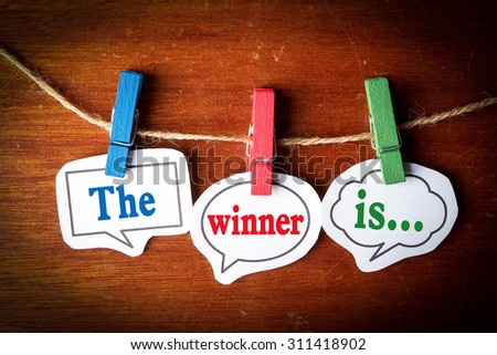The winner is concept paper speech bubbles with line on the wooden background. Royalty-Free Stock Photo #311418902
