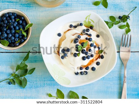 Pancakes with sour cream, blueberries and honey #311522804