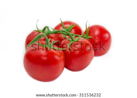 Branch with a red ripe tomatoes on a light background. Isolation.