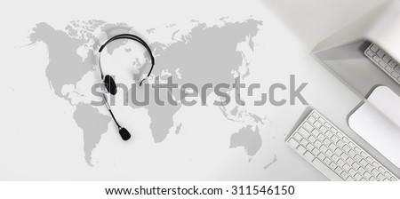contact global concept , top view desk with headset, computer and map Royalty-Free Stock Photo #311546150