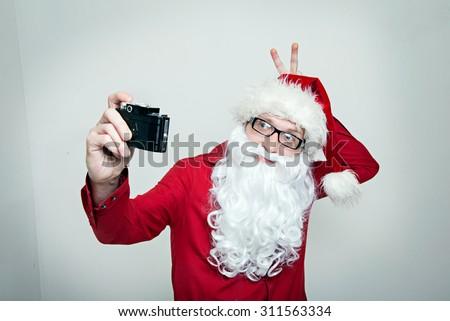 Hipster Santa fool around making selfie