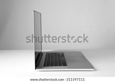 Laptop on gray background #311597111