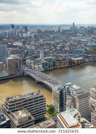 LONDON, UK - APRIL 22, 2015: City of London view. Panoramic view from the 32 floor of London's skyscraper #311625635