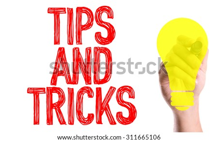 Hand with marker writing the word Tips and Tricks