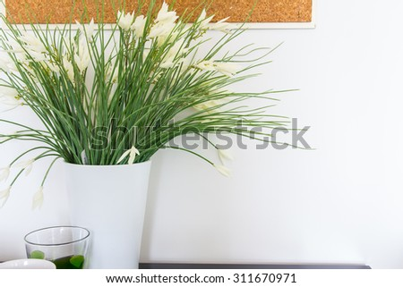 Modern interior decorated with flowers #311670971