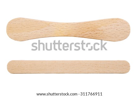 Wooden ice-cream sticks isolated on white background Royalty-Free Stock Photo #311766911