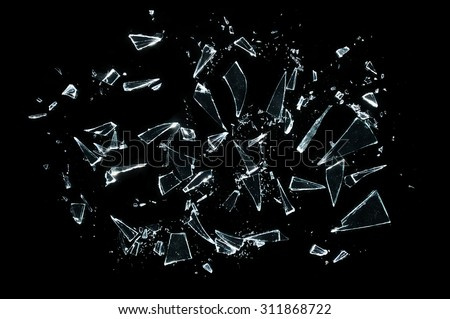 broken glass with sharp Pieces over black  Royalty-Free Stock Photo #311868722