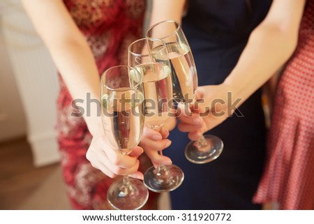 three glasses of champagne close-up women at a party #311920772