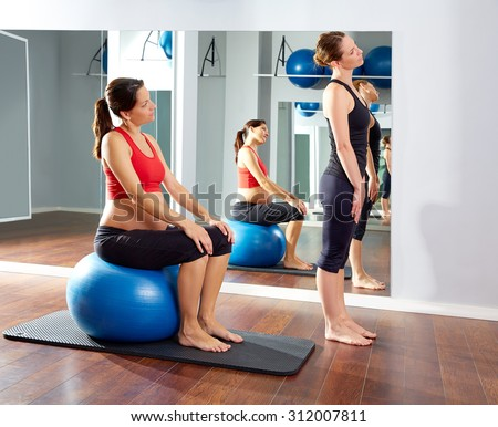 pregnant woman pilates exercise fitball at gym with personal trainer #312007811
