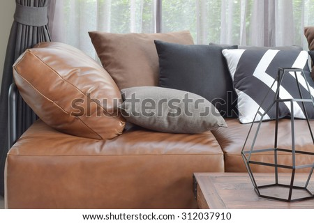 Light brown leather sofa bed with varies color and size pillows #312037910