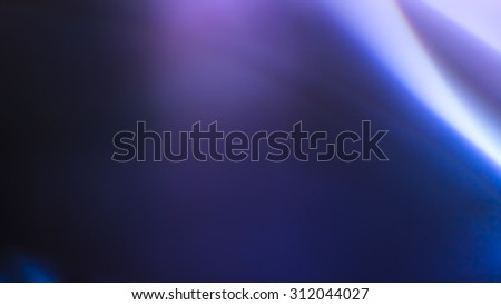 beautiful light leak in hd quality on dark background with colorful tones.