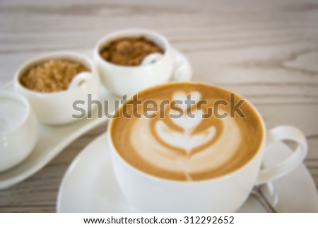 Defocused and blurred image for background of latte art with different kinds of sugar on wooden table